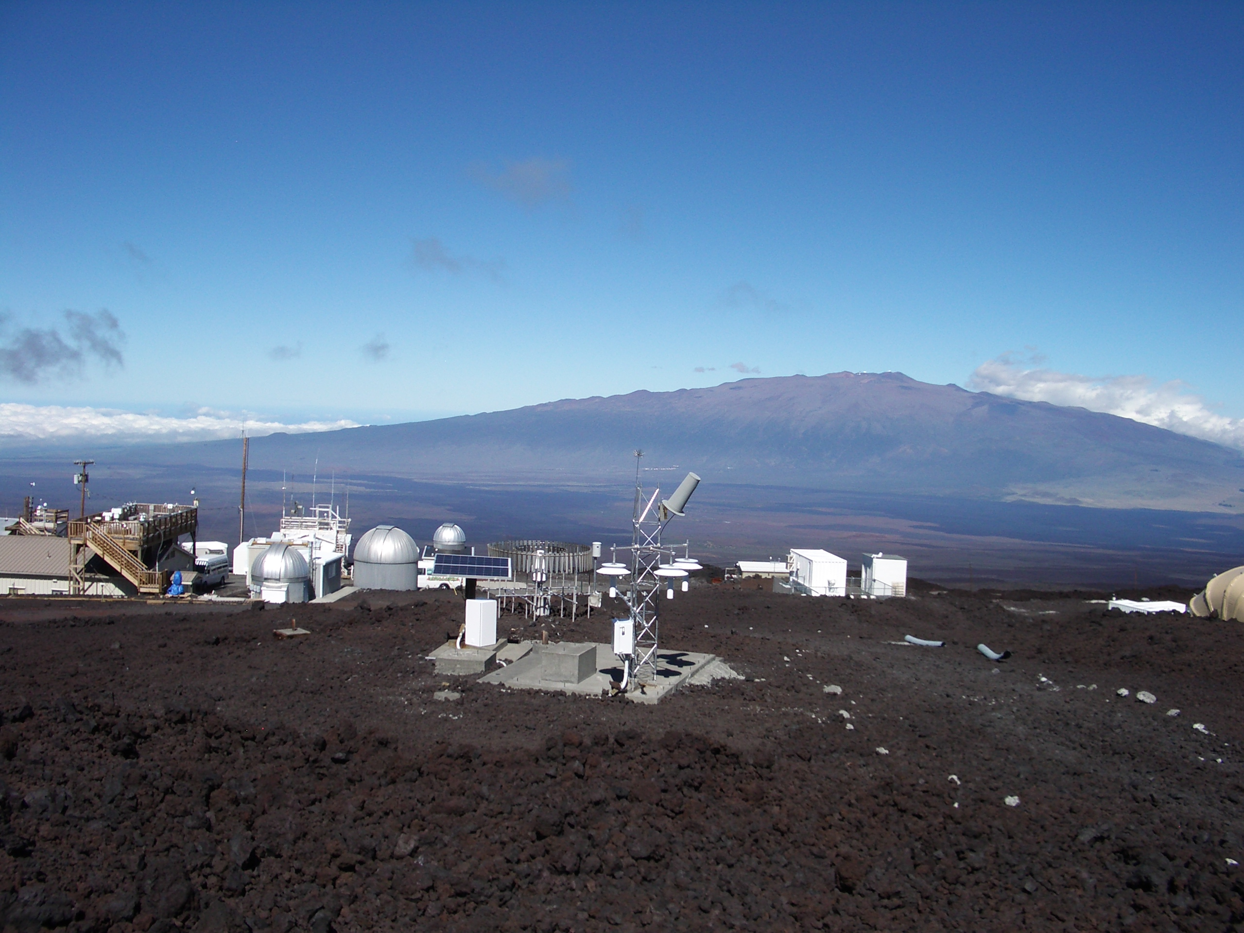 U.S. Climate Reference Network climate observing station on Mauna Loa in Hawaii  (Mauna Kea in the background).