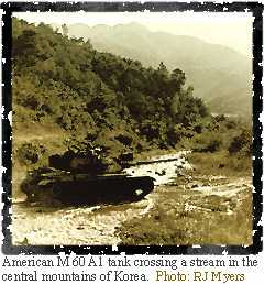 Image of an American M 60 A1 tank crossing a stream in the central mountains of Korea.